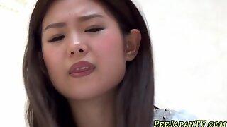 Asian teen peeing blue