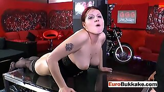 Chubby redhead in lingerie gets banged and pissed on