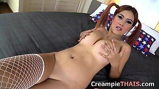 Jism filled snatch on big boob Thai girl