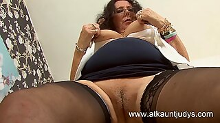 Zadi rubs and fingers her pussy in the office.
