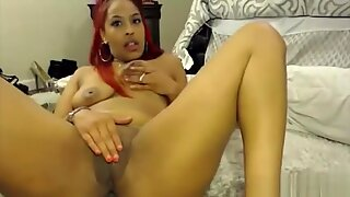 Redhead Phoenix with huge flexible butt