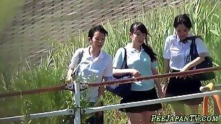 Teen students pee outside