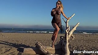 Naked masturbating with dildo to the beach