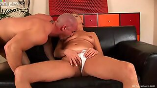 Lustful granny Bettany masturbates on a couch and gets fucked by Markus Waxenegger